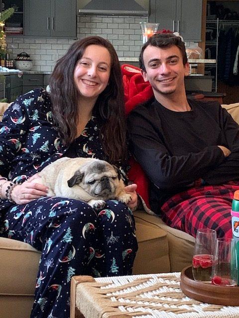 kids holding a pug
